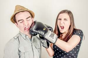 angry woman-man being punched-mad woman-boxing gloves